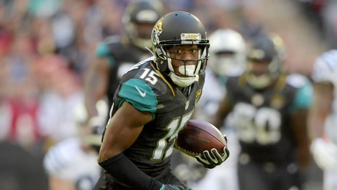 Jacksonville Jaguars wide receiver Allen Robinson (15) carries the ball against the Indianapolis Colts during game 15 of the NFL International Series at Wembley Stadium.