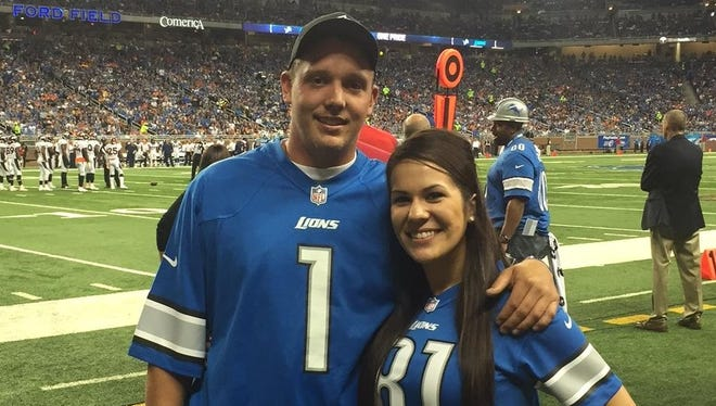 Westland resident Chad Tuisku is pictured with his girlfriend, Shelby Dixon, during Sunday night's Denver-Detroit NFL game.