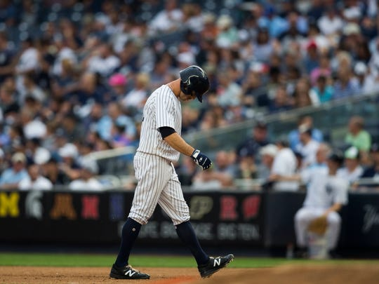 New York Yankees Brett Gardner bows his head after his pop fly is caught during the sixth inning of a baseball game against the Detroit Tigers on Wednesday, Aug. 2, 2017, in New York.