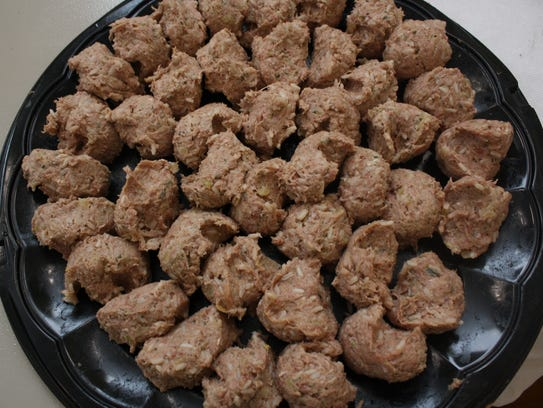 Quarter-cups of meat, seasoned with rice and other