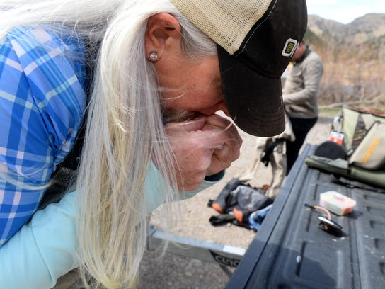 Diane Wright ties on a fly before an afternoon fishing