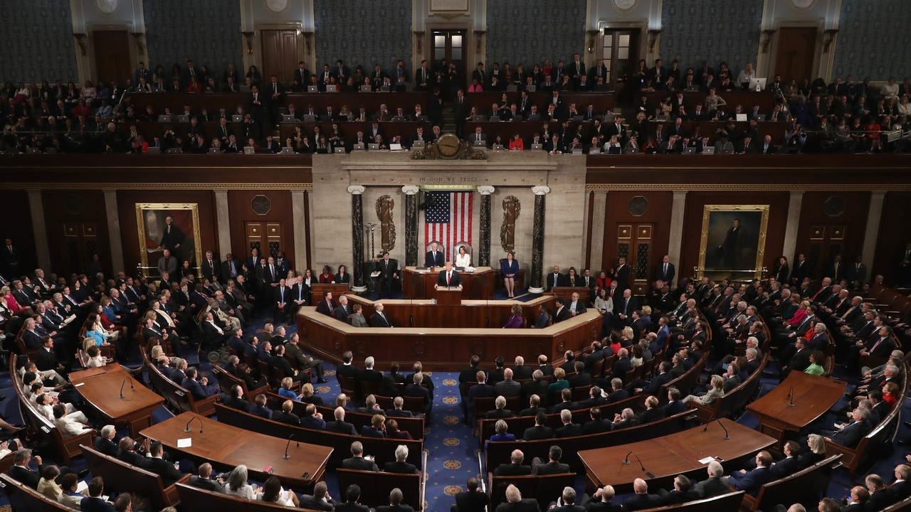 d2705acf93966 Melania Trump arrives solo, contrasts Dems in white with dark dress at  State of the Union