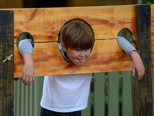 Finley Spring tries out the stocks at the annual Historic Pensacola Open House at Historic Pensacola Village. This year's event is Saturday from 10 a.m. to 4 p.m.