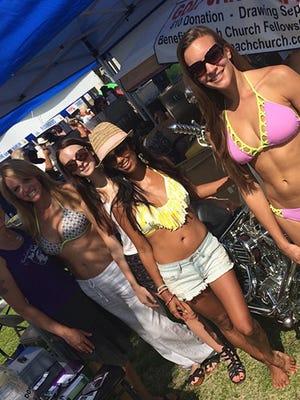 Pixie Productions' Laura Stearns, Rachael Freeland, Savannah Eades, Raela Villanueva and Ryean Freeland help sell raffle tickets for the AHERO Foundation at last year's Taste of the Beach.