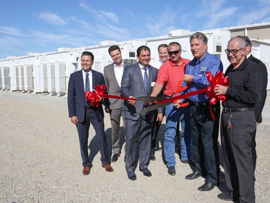 Officials including then-IID board member Matt Dessert (in blue) and Mike Abatti (in red) cut a ribbon to celebrate the opening of IID's battery on Oct. 26, 2016.