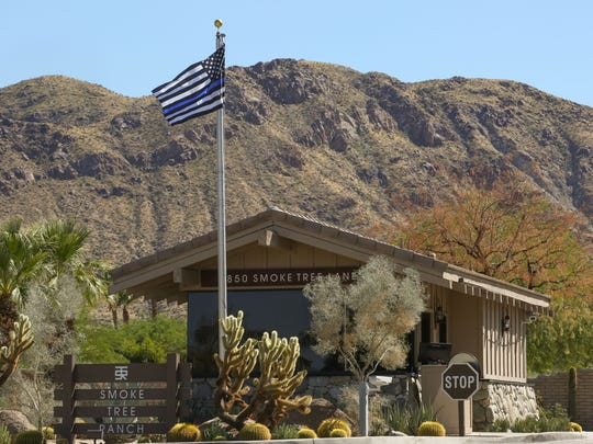 A thin blue line flag recognizing fallen police officers flies at the Smoke Tree Ranchy in Palm Springs, September 27, 2017.