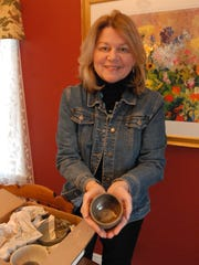 Eileen Jay holds a small bowl made for the Empty Bowls fundraiser.