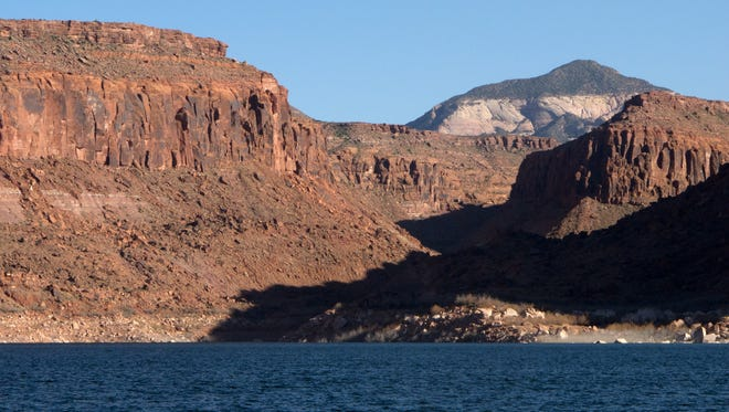 Navajo Mountain looms above one of the side canyons on the San Juan arm of Lake Powell.