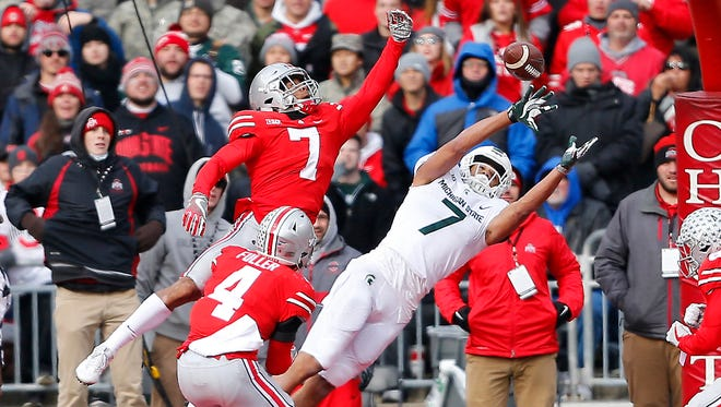 MSU receiver Cody White dives unsuccessfully for a pass in the end zone late in the second quarter of Saturday's loss at Ohio State. White took a ferocious hit as he tried to haul in the catch.