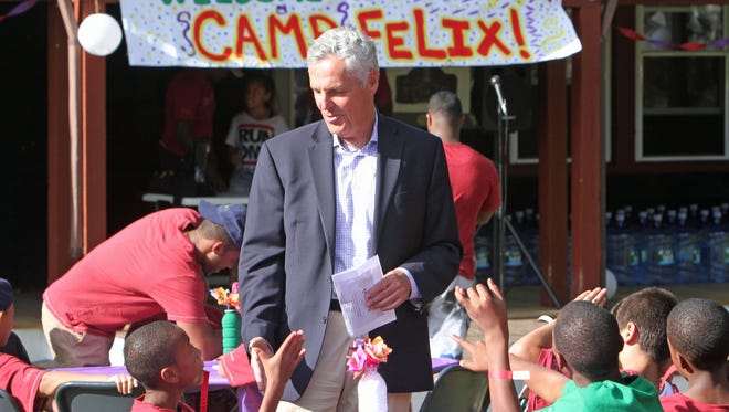 Bill Baccaglini, President and CEO of The New York Foundling, talks with some of the campers at Camp Felix, prior to the start of the talent show at the camp in Putnam Valley on Wednesday, Aug. 12, 2015. Camp Felix is for kids ages 8 to 15 in the New York foster care system from New York City