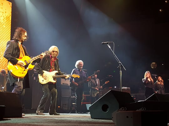 Mike Campbell, from left, Tom Petty, Ron Blair, Scott Thurston, Hattie Webb and Charley Webb perform during the Heartbreakers' 40th anniversary tour stop in Baltimore.