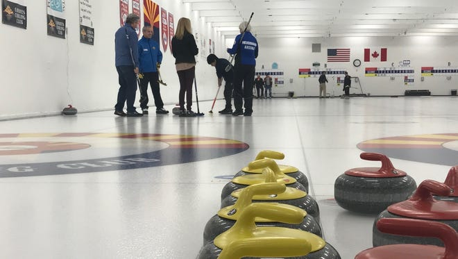 The Leavitts try curling for the first time at the Coyotes Curling Club in Tempe on Feb. 10, 2018.