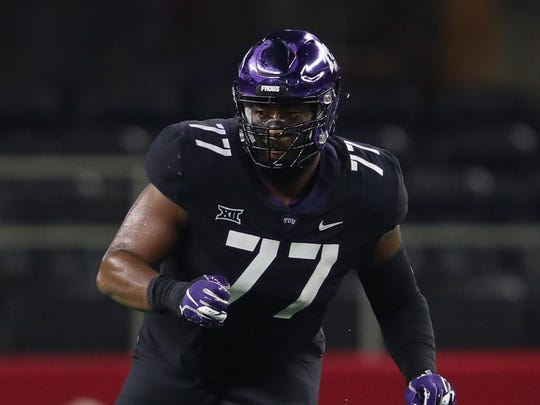 Sep 15, 2018; Arlington, TX, USA; Texas Christian Horned Frogs tackle Lucas Niang (77) in action against the Ohio State Buckeyes at AT&T Stadium. Mandatory Credit: Matthew Emmons-USA TODAY Sports