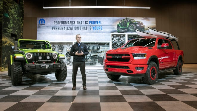 Pietro Gorlier, Head of Parts and Service, Mopar, showcases customized versions of the 2018 Jeep Wrangler and the 2019 Ram 1500 at the Chicago Auto Show in February 2018.