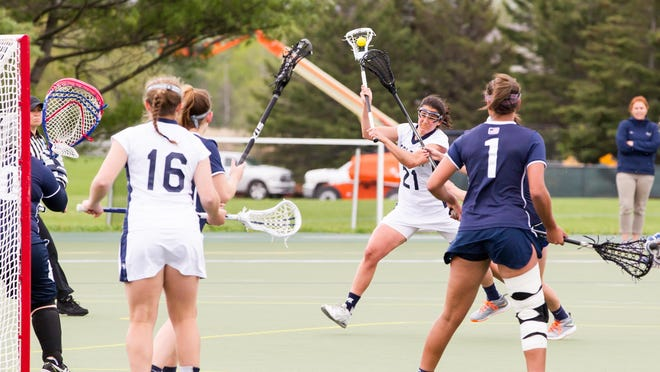Middlebury's Megan Griffin takes a shot during Saturday's Division III NCAA Regional second round game in Middlebury.