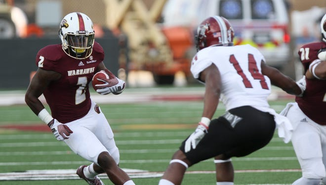 ULM receiver Rashon Ceaser tries to make a bigger gain after a reception after Troy. The Warhawks travel to their second of three SEC opponents this season when they take on Kentucky Saturday at 11 a.m.