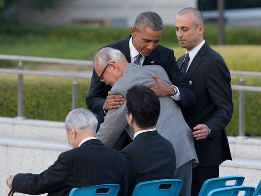 U.S. President Obama hugs Shigeaki Mori, an atomic