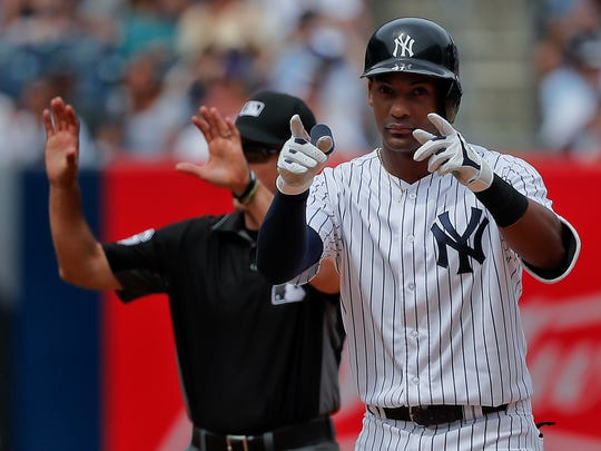 New York Yankees' Miguel Andujar reacts after doubling
