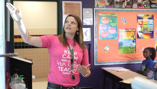 Ashley Loyd teaches a fourth-grade geography lesson at Cypress Point Elementary School on Friday. Monroe City Schools have adopted a nine-week grading period across the district.