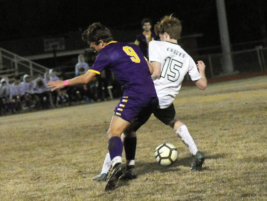 Alexandria Senior High School's Dylan Comeaux (9) and