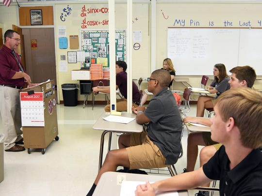 Teacher George Pennell goes over expectations with