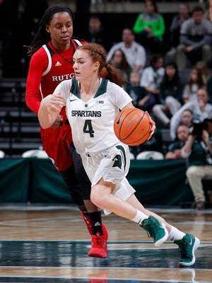 Michigan State's Taryn McCutcheon (4) drives against Rutgers' Tekia Mack, Sunday, Dec. 31, 2017, in East Lansing, Mich. MSU fell 61-58.