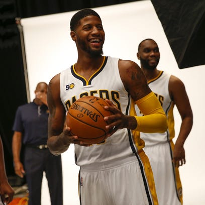 Indiana Pacers forward Paul George (13) shares a laugh