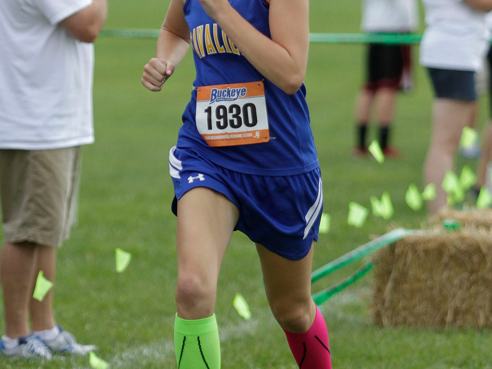 Kansas Greenwell of Purcell Marian runs with her signature socks at the Mason Invitational Sept. 6.