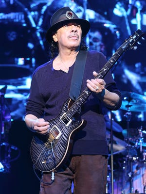 Carlos Santana performs during a show in 2014.