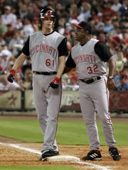 6-4-06, 6D  Cincinnati Reds pitcher Bronson Arroyo (61) is congratulated by first base coach Billy Hatcher after Bronson got his third hit of the night, during the sixth inning of a baseball game against the Houston Astros on Saturday, June 3, 2006, in Houston. (AP Photo/Dave Einsel)