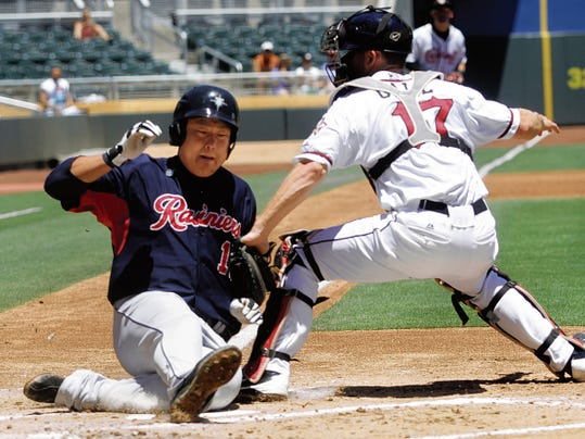 In this Times file photo, Catcher Rocky Gale tags out Tacoma's Ji-Man Choi as he tries to score on a Tacoma single.
