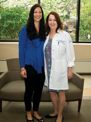 Falicia Chance stands with Diane Froman, her patient navigator.