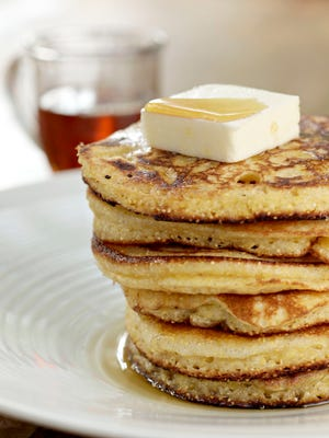 Serve golden, cripsy polenta hoecakes with butter and warm maple syrup.