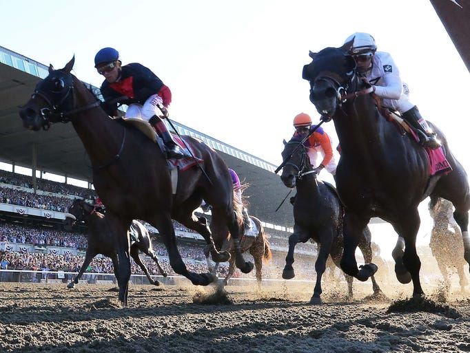 Joel Rosario aboard Tonalist wins the 2014 Belmont Stakes ahead of Javier Castellano aboard Commissioner and Robby Albarado aboard Medal Count.