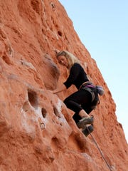 Malynda Madsen, a former climbing guide for Green Valley Spa, navigates the Chuckwalla Wall in St. George.