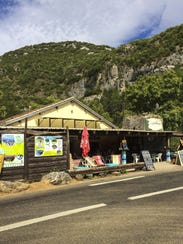 An open-air cafe by a river swimming hole in the Cevennes