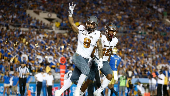 ASU'€™s D.J. Foster scores a touchdown against UCLA in the second half on Oct. 3, 2015, at the Rose Bowl in Pasadena, Calif.