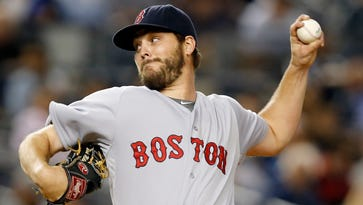 Boston Red Sox starting pitcher Wade Miley delivers in the first inning of a baseball game against the New York Yankees,  in New York. The Seattle Mariners have obtained left-hander Wade Miley and reliever Jonathan Aro from the Boston Red Sox for reliever Carson Smith and pitcher Roenis Elias, Monday, Dec. 7, 2015.