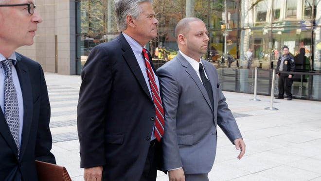 New York Senate Majority Leader Dean Skelos, center, and his son Adam, right, arrive at FBI offices on Monday.