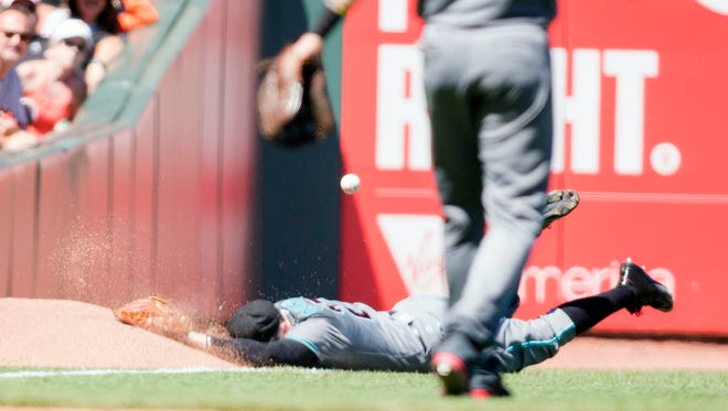 Jul 9, 2016: Arizona Diamondbacks left fielder Brandon Drury (27) dives for a fly ball in the sixth inning against the San Francisco Giants at AT&T Park.