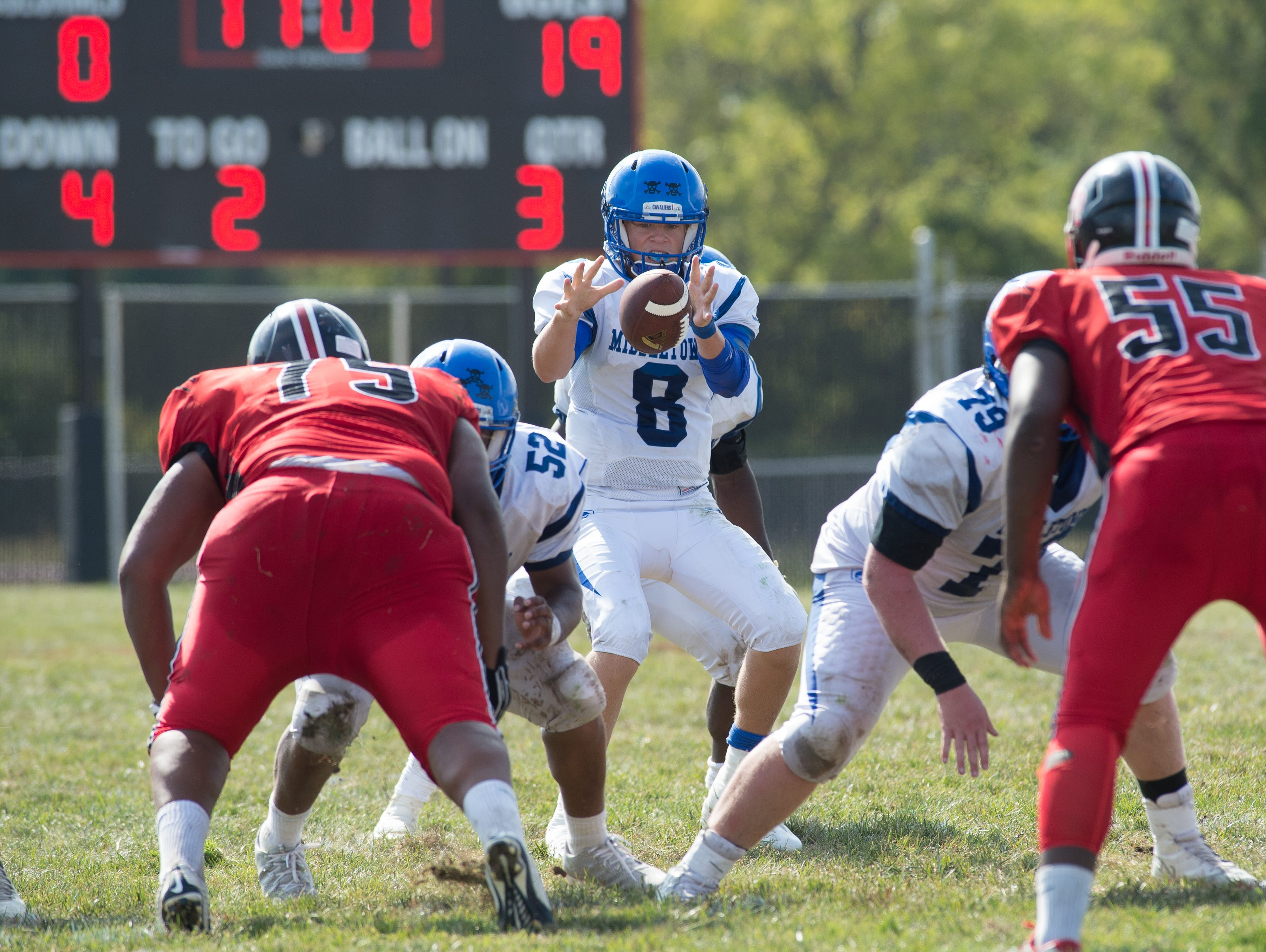 Middletown's quarterback Drew Fry (8) hikes the ball in their game against William Penn.