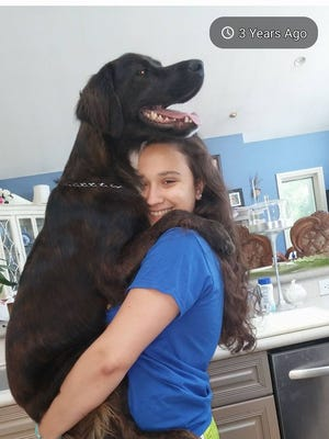"""Bethany Anne Galdes with her dog, Kodiak. Bethany's mom said Kodiak provided """"the reason for Bethany to get out of bed in the morning."""""""