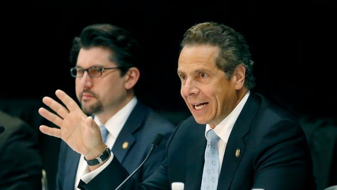 """Gov. Andrew Cuomo stops by the Rochester Riverside Convention Center in Rochester for a discussion on poverty and economic development during his """"Capital for a Day"""" tour."""