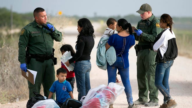 Some women and children from Honduras are apprehended by Border Patrol not far from the border with Mexico at the Rio Grande river in Mission, Texas, on June 21.