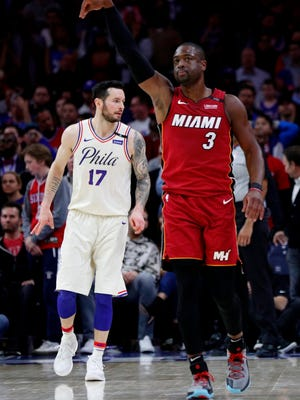Miami Heat's Dwyane Wade reacts to his basket in the last minute of the second half in Game 2 of a first-round playoff series against the Philadelphia 76ers on Monday in Philadelphia. The Heat won 113-103.