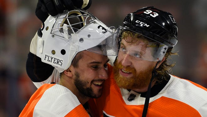 Jake Voracek passed the Flyers' player of the game robe to his countryman, goalie Petr Mrazek.