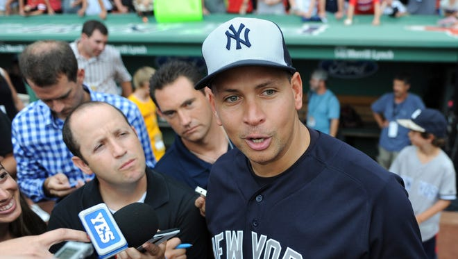 New York Yankees designated hitter Alex Rodriguez (13) speaks to the media prior to a game against the Boston Red Sox at Fenway Park.