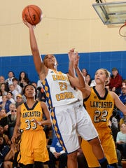Wren's Nakol Franks (23) drives to the basket past