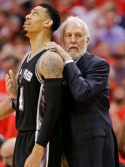 San Antonio Spurs coach Gregg Popovich, right, calms down guard Danny Green after Green was called for a technical foul during the second half in Game 6 of the team's NBA basketball second-round playoff series against the Houston Rockets, Thursday, May 11, 2017, in Houston. San Antonio won 114-75. (AP Photo/Eric Christian Smith)
