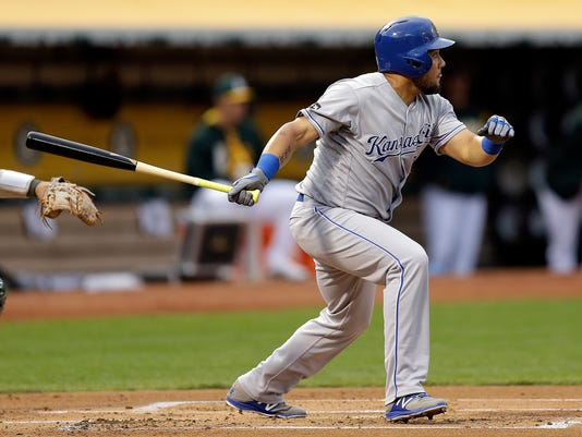 Kansas City Royals' Melky Cabrera watches his RBI single hit off Oakland Athletics' Chris Smith in the first inning of a baseball game Tuesday, Aug. 15, 2017, in Oakland, Calif. (AP Photo/Ben Margot)